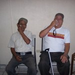 Lazaro and Pedro get their pre-op drops in Dr. Guerra's office